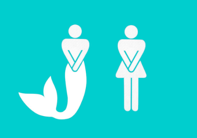 toilet sign with mermaid and woman